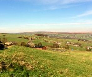 In Harmony with Horses timber barn on Yorkshire Pennine hillside